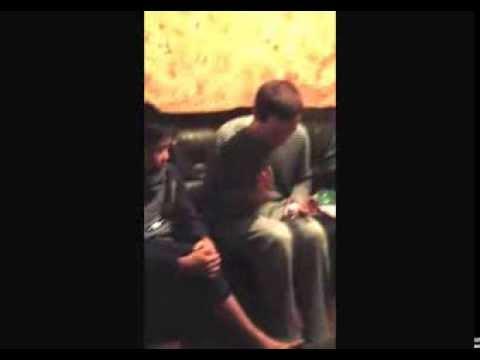 Ian o'Brien shows Taichi how to play the PET Bottle