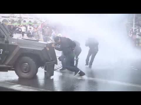 Police in Chile fire water cannon in student clashes, as protest in Santiago turns violent