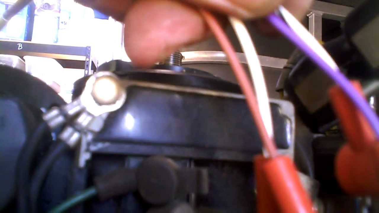 diagnostic under the flywheel on a mercury outboad motor trigger stator youtube [ 1280 x 720 Pixel ]