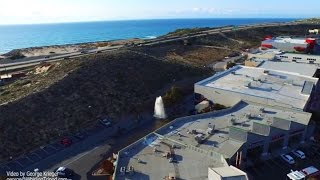 Drone Video: Geyser Towers Above Sand City Buildings