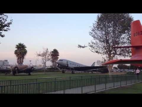 Airliner landing across from The Proud Bird