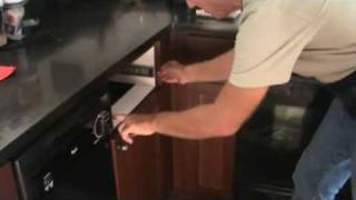 Removing a cabinet drawer with full extension hardware