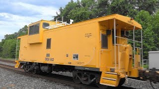 Yellow DODX Caboose On The Rear Of CSX Mixed Freight Train