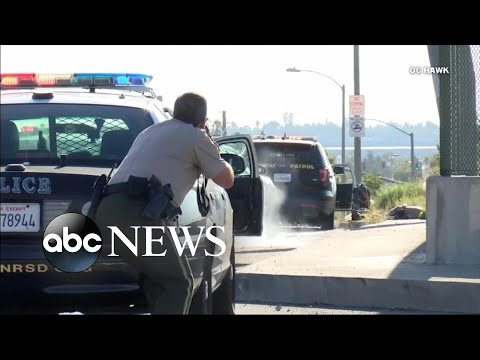 Officer, suspect die in traffic stop shootout l ABC News