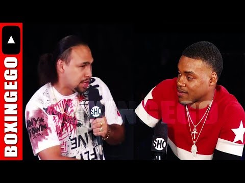 ERROL SPENCE JR MEAN-MUGGING KEITH THURMAN ON THE PODIUM; DOES THURMAN WANT THE SPENCE FIGHT?
