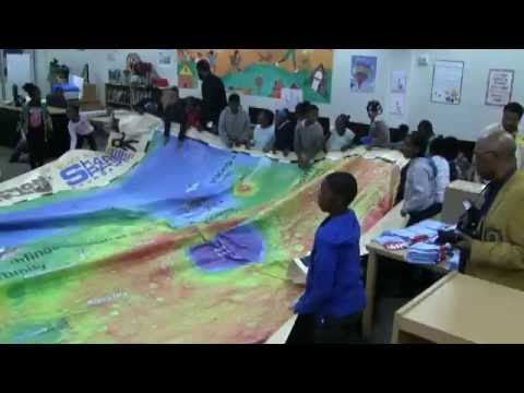 Buzz Aldrin's ShareSpace Delivers Giant Mars Map to Dunbar Elementary