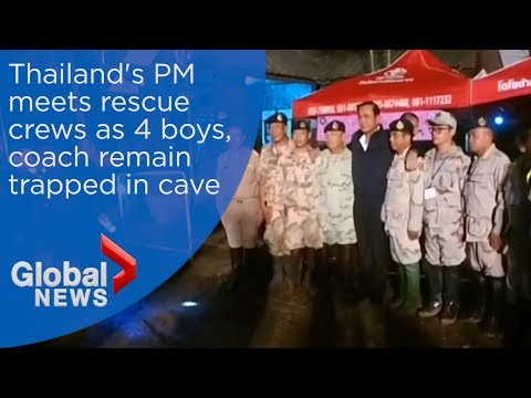 Thailand's PM tours cave site 4 boys remain trapped
