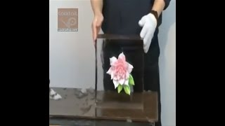 Sculpturing a flower into a block of ice