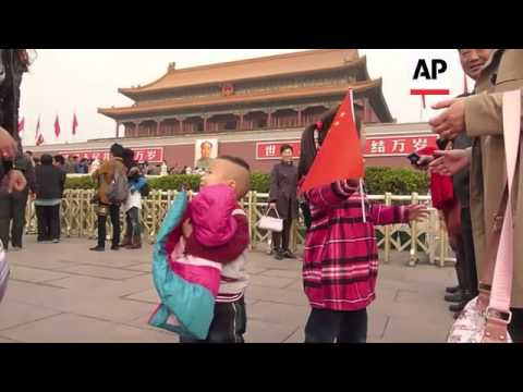 Reaction after police announce arrests in Tiananmen attack; security