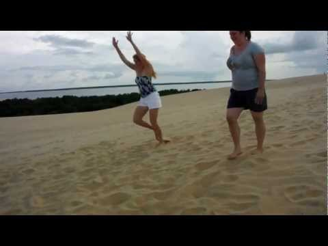 Roxanne and Janna cartwheels in sand dunes at Jockey Ridge State Park in Kitty Hawk, NC