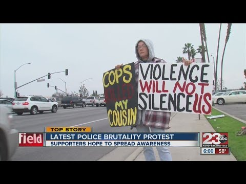 Protesters against police brutality block road
