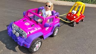 Cute Little Girl Elis Ride On Jeep My Little Pony Power Wheel with Cozy Coupe Little Tikes and Doll