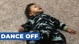 One-Year-Old Baby and Dad Engage in a Dance Off