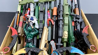 Boxes Of Toy Rifles, Wooden Weapons, Karambit Knives, Military Rifles And Military Equipment