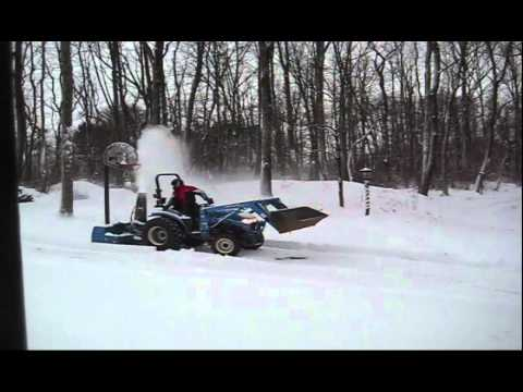 New Holland Tc33d Tractor Pushing A Nh 74csr Snow Blower