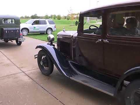 Antique cars drive through Fairfield Loop Trail