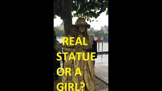 STATUE OR A GIRL? Comment your answer #shorts