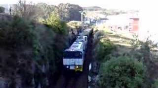 Container train in narrow gauge Xove Spain