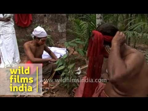 Men looks at mirror after make-up, Kerala