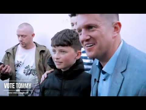 Tommy Robinson greeting supporters in Wythenshawe.