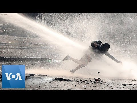 Water Cannons And Tear Gas Used As Chile Protest Turns Violent