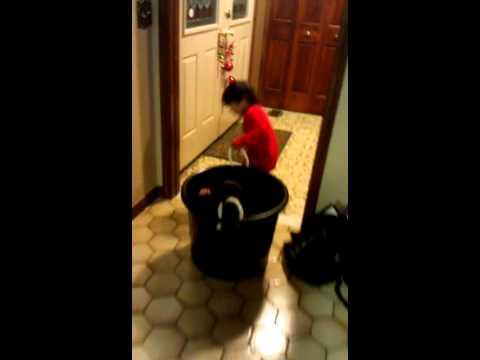 Raphael pulling a bucket with Gabriel inside the b