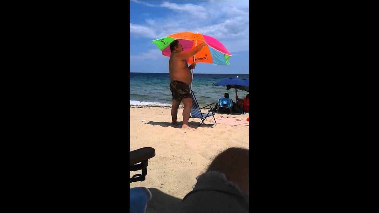 How To Properly Put Up A Beach Umbrella
