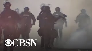 Federal agents use tear gas to clear out demonstrators during clashes in Portland