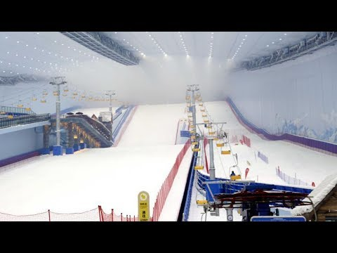 World's largest indoor ski resort opens in China's ice city
