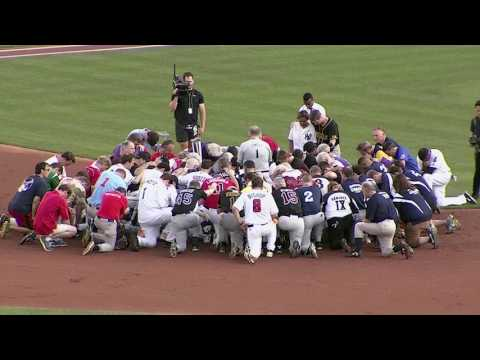 Republicans and Democrats pray together before Congressional Baseball Game