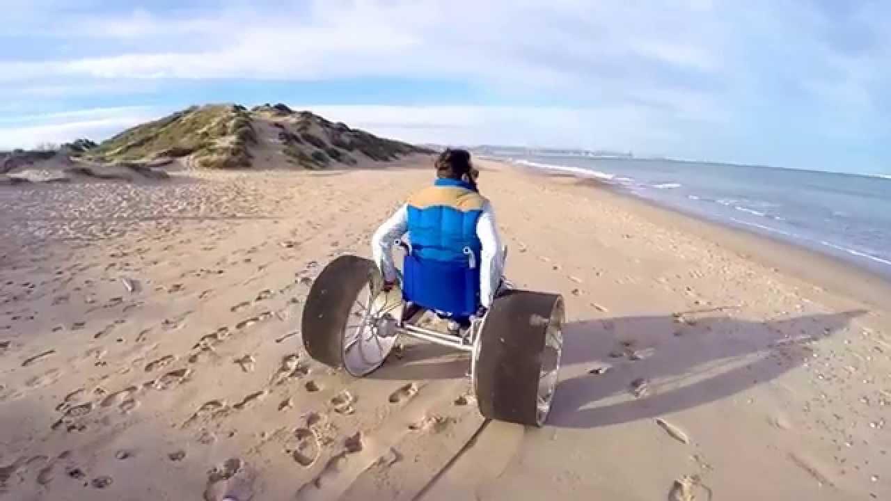 SandRoller (beach wheelchair) rolling on the beach - YouTube