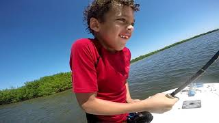 Solomon and Elijah's fishing adventure with dad and captain Elmer