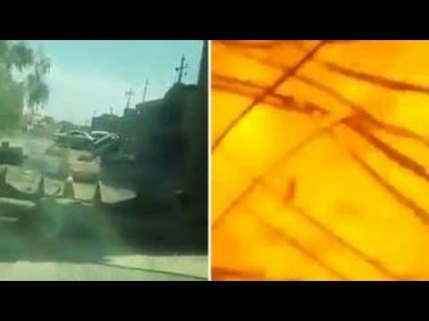 Iraqi soldier uses bulldozer to block incoming car bomb