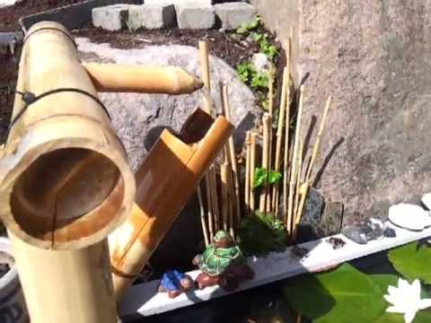 Bird scarer shishi odoshi fountain made of bamboo using doovi - Shishi odoshi bamboo water feature ...