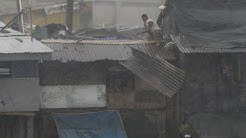 "Typhoon ""Glenda"" shuts down Metro Manila, leaves 20 dead"