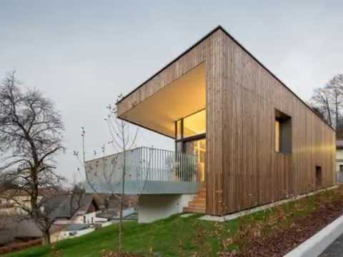 modern style house with wooden skin created on the interesting slope