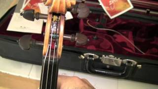 Changing Strings on a Violin by Fiddlerman
