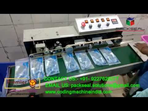 HIGH SPEED CONTINOUS BAND SEALER WITH AIR SUCTION AND BATCH CODING
