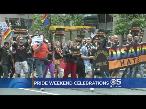 PRIDE PARADE:  Marchers deliver a political message of resist during annual Pride Parade