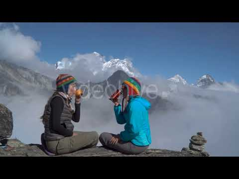 Two Girls Are Drinking Tea in the Mountains- Videohive