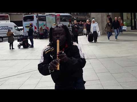 Flute played by African in koln Dom