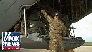 Raw Video: Troops, military equipment arrive in Texas