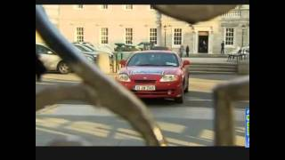 TD drives off the steps of Leinster house.