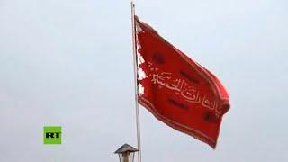 Bandera roja es levantada sobre una mezquita iraní