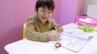 Xavi does his homework hard