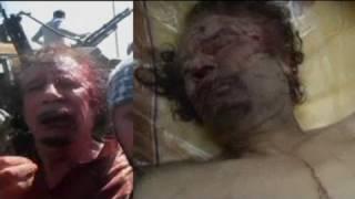 Repeat youtube video Los rebeldes libios muestran el cuerpo de Gadafi como trofeo