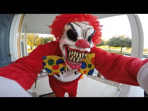 scary clown giving out
