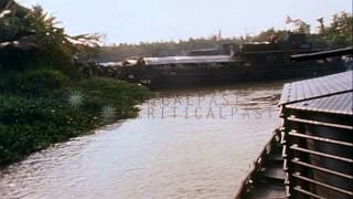 Assault Patrol Boats and Landing Craft (Monitor) underway in a river in Vietnam. HD Stock Footage