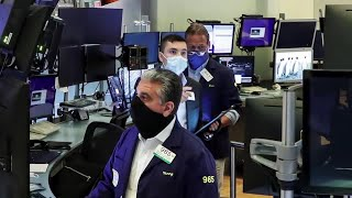 Masked traders, Cuomo re-open iconic NYSE