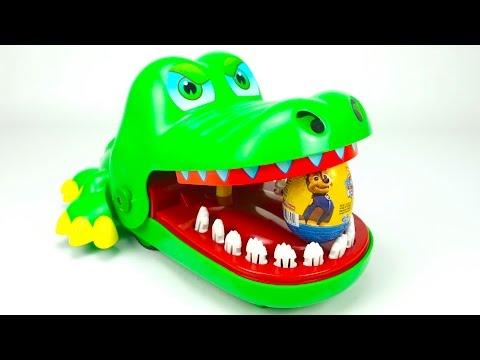 Сюрпризы и игрушка крокодил кусака